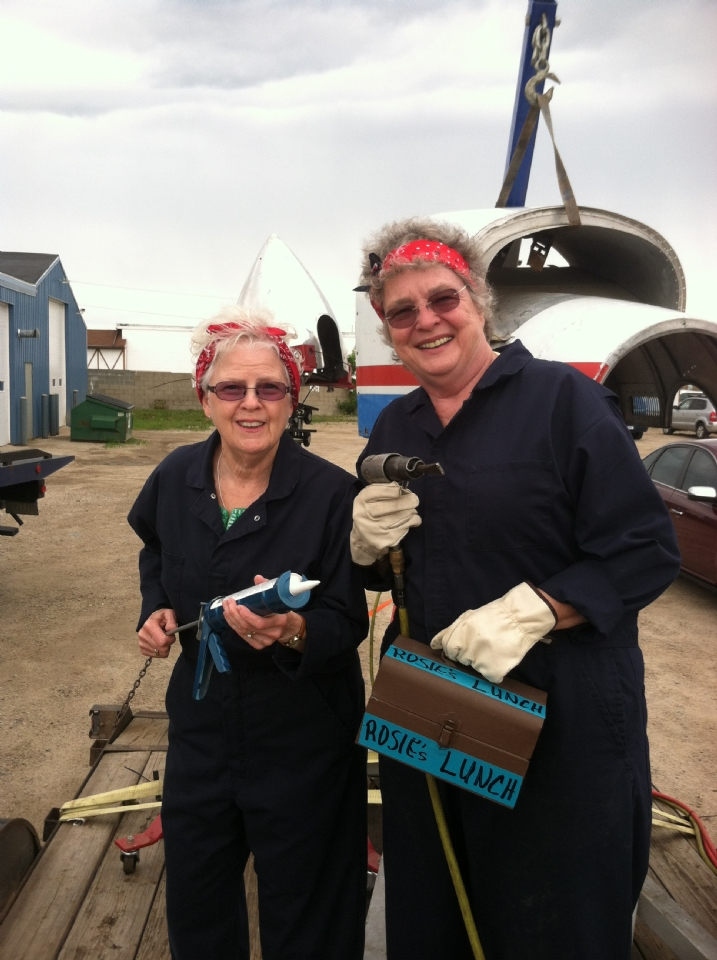 Mary Kay LeBourdais & Polly Buchanan ready to work making WWII airplanes! Alpenfest 2015