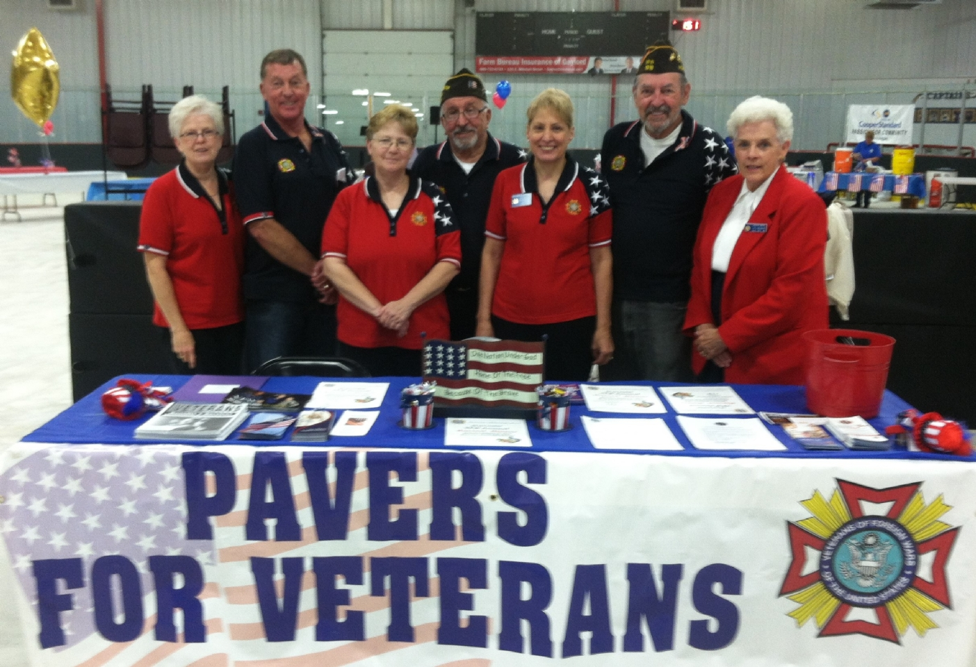 VFW and Auxiliary members distribute paver applications during this event.