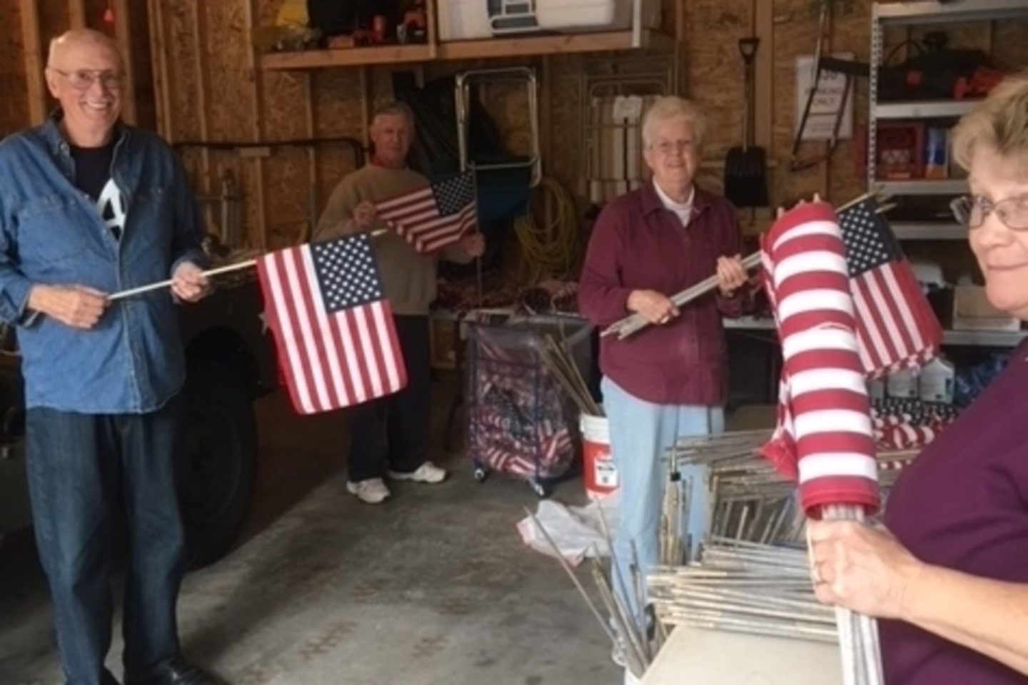 Members sort flags to reuse at area schools.